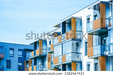 Fragment of Apartment house and home residential buildings complex real estate concept. Place for copy space. With blue sky #1382467421