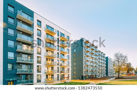 New apartment house residential building outdoor concept. Street and backgrounds. #1382473550
