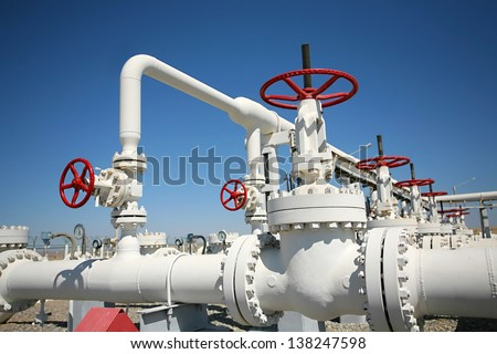 Oil and gas processing plant with pipe line valves Royalty-Free Stock Photo #138247598