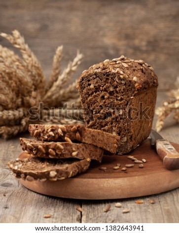 bread with seeds on old wooden background in a rustic style #1382643941