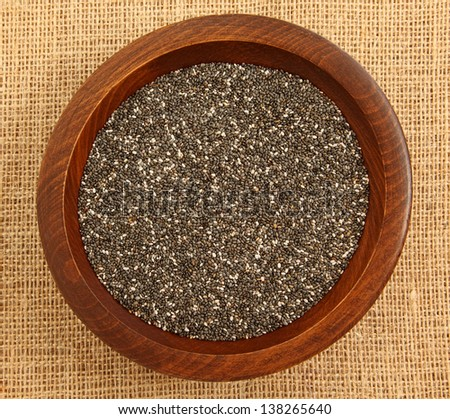 Close Up Of Chia Seeds In Wooden Bowl On Burlap Bag #138265640