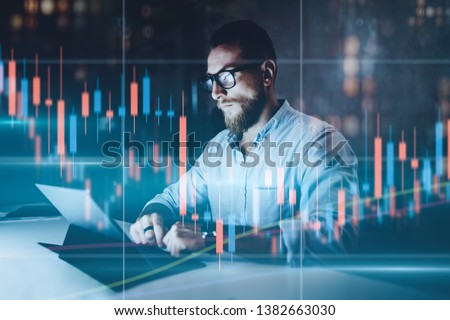 Double exposure.Market traider making analysis of digital market and investment in block chain crypto currency. Red and green candlestick chart and stock trading computer screen background #1382663030