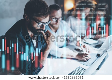 Business team working together at night office.Technical price graph and indicator, red and green candlestick chart and stock trading computer screen background. Double exposure. #1382663051