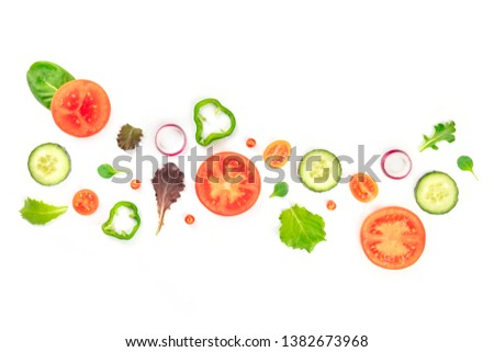 Fresh vegan vegetable salad ingredients, shot from the top on a white background. A flat lay composition with organic tomato, cucumber, peppers, onion slices and mezclun leaves #1382673968