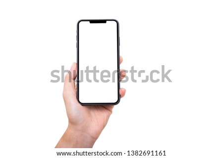 Hand holding new smartphone on white background Royalty-Free Stock Photo #1382691161