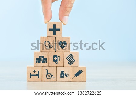 Health Insurance Concept,hand arranging wood block stacking with icon healthcare medical. #1382722625