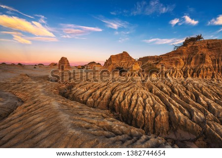 Sunset over Walls of China in Mungo National Park, New South Wales, Australia #1382744654