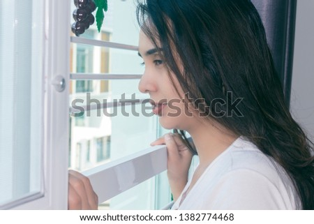 Side view portrait of a thoughtful attractive female in  home #1382774468