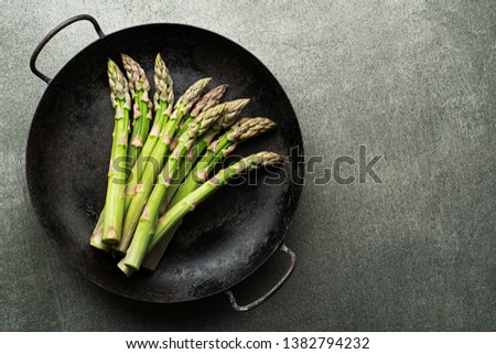 Fresh of green Asparagus. Cooking healthy meal in pan. Bunches of green asparagus, top view- Image #1382794232