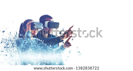 A man and a woman in glasses of virtual reality. The concept of modern technologies and technologies of the future. Fragmented by pixels. VR glasses. #1382838722