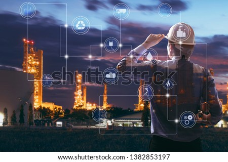 Double exposure of Engineer with oil refinery industry plant background,  industrial instruments in the factory and physical system icons concept, Industry 4.0 concept image #1382853197
