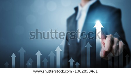 Business development to success and growing growth concept. Businessman pointing arrow graph corporate future growth plan #1382853461