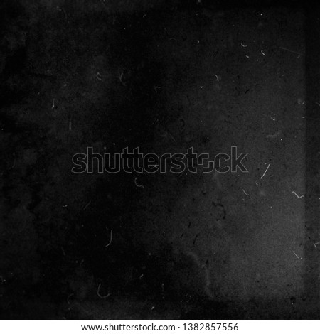 Black grunge scratched background, scary obsolete dusty texture, old film effect #1382857556