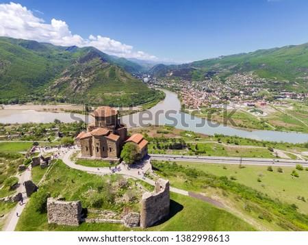 Jvari Monastery is sixth century Georgian Orthodox monastery near Mtskheta, eastern Georgia. Along with other historic structures of Mtskheta. Jvari Monastery stands on rocky mountaintop at Mtkvari. #1382998613