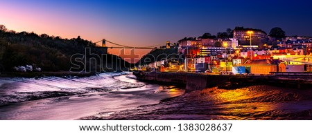 Panoramic photo of Clifton Suspension Bridge over the river Avon and Clifton Village, Bristol, England UK taken in the Blue Hour Royalty-Free Stock Photo #1383028637