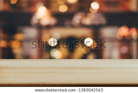 Selective Empty wooden table in front of abstract blurred festive light background with light spots and bokeh for product montage display of product. #1383042563