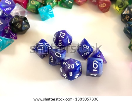 A basic set of dice used for many role playing games which includes a 20-sided, a 12-sided, a 10-sided, a 8-sided, a 6-sided, 4-sided dice, and a percentile dice. #1383057338
