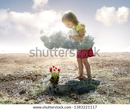 A little girl grabs a cloud and pours rain on some pink tulips Royalty-Free Stock Photo #1383221117