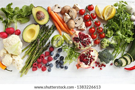 Healthy food. Selection of vegetables, fruits and berries for ketogenic diet, clean eating, plant based, vegetarian and super food concept. Royalty-Free Stock Photo #1383226613