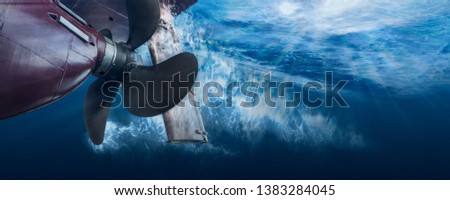 Propeller and rudder of big ship underway from underwater. Close up image detail of ship. Transportation industry. Freight transportation. Ship repair, underwater survey and shipping business concept #1383284045