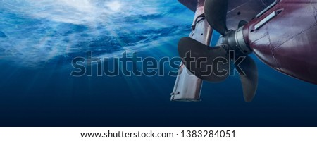 Propeller and rudder of big ship underway from underwater. Close up image detail of ship. Transportation industry. Freight transportation. Ship repair, underwater survey and shipping business concept #1383284051