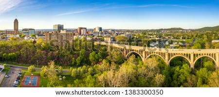Aerial panorama of Allentown, Pennsylvania skyline and Albertus L. Meyers Bridge (aka Eighth Street Bridge) on late sunny afternoon . Allentown is Pennsylvania's third most populous city. #1383300350