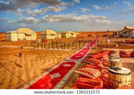 Desert tents at a luxury camp site at Erg Chebbi in the Moroccan Sahara Royalty-Free Stock Photo #1383312575