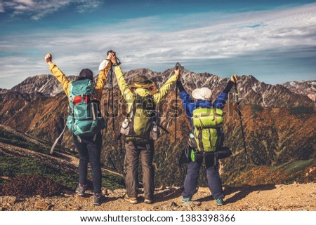 Epic adventure of hiker do trekking activity in mountain of Northern Japan Alps, Nagano, Japan, with panoramic nature mountain range landscape. Motivation leisure sport and discovery travel concept. #1383398366
