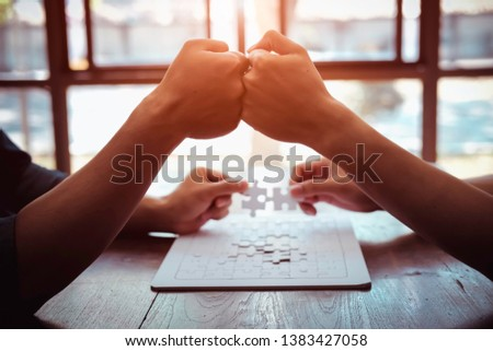 Closeup hand of business people connecting jigsaw puzzle with sunlight effect, Business solutions and represent team support and help concept, success and strategy concept #1383427058