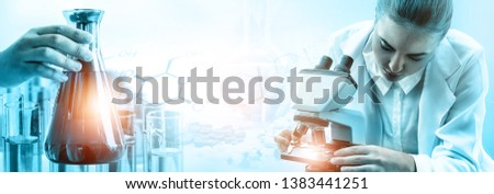 Research and development concept. Double exposure image of scientific and medical lab instrument, microscope, test tube and glass flask for microbiology and chemistry in laboratory for medicine study. Royalty-Free Stock Photo #1383441251