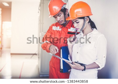 engineer or electrician working on checking and maintenance equipment #1383443858