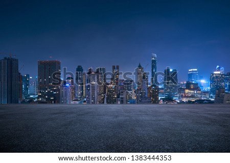 Bangkok urban cityscape skyline night scene with empty asphalt floor on front #1383444353