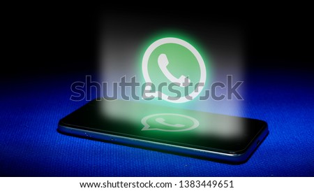 Magelang, Central Java, Indonesia, April 29, 2019.Hologram of whatsapp logo. hologram whatsapp logo image on blue background . The concept of next technology,social media, - Image #1383449651