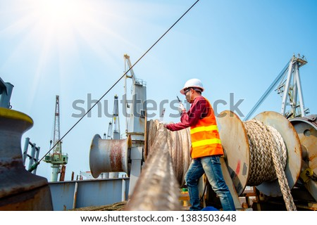 engineering ship crew under safe working in communicating for mooring wince on board the ship, arrival and departure or berthing, un-berthing of the ship perform by the crew member working in charge Royalty-Free Stock Photo #1383503648