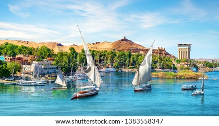 River Nile and boats at sunset in Aswan #1383558347