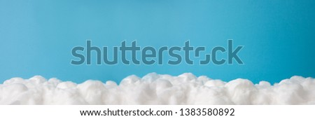 cloud made out of cotton wool on sky blue background #1383580892