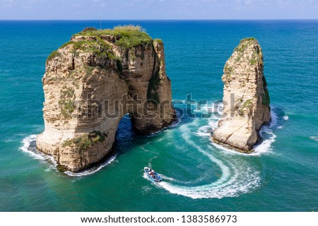Rouche rocks in Beirut, Lebanon in the sea during daytime. Pigeon Rocks in Mediterranean sea. Royalty-Free Stock Photo #1383586973