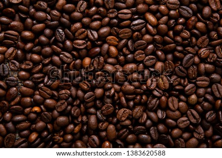 Roasted coffee beans closeup. Background #1383620588