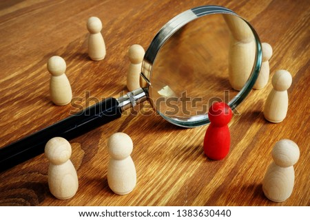 Talent acquisition and management. Magnifying glass and gavel. Royalty-Free Stock Photo #1383630440