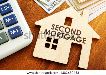 Second Mortgage written on wooden home. #1383630458