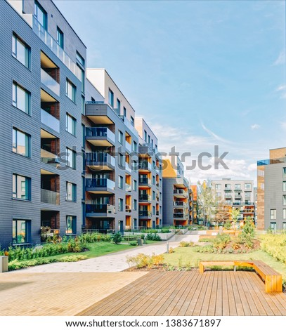 Benches at Modern architectural complex of apartment residential buildings. And outdoor facilities. #1383671897