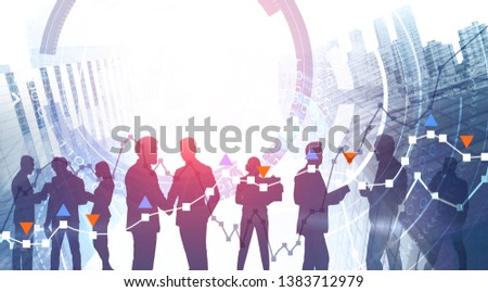 Silhouettes of business people over skyscraper background with double exposure of HUD interface and graphs. Financial analysis concept. Toned image #1383712979