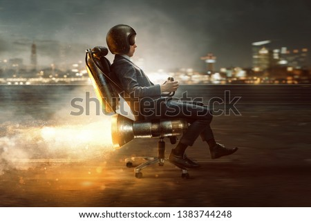 Businessman rolls on office chair with rocket motor #1383744248