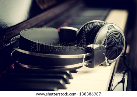 Piano keyboard with headphones for music Royalty-Free Stock Photo #138386987