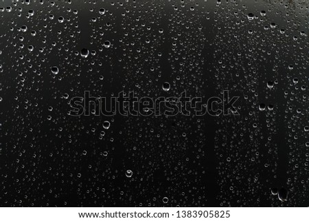 black wet background / raindrops for overlaying on window, concept of autumn weather, background of drops of water rain on glass transparent #1383905825