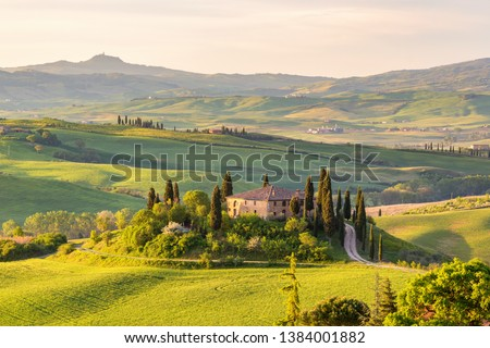 Farm house on a hill in Tuscany landscape #1384001882