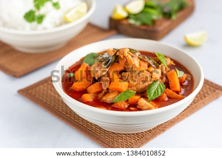 Thai Red Chicken Curry in a Bowl Served with Rice and Lemon. Flavorful Thai Red Curry with Basil Leaves, Thai Food, Thai Cuisine, Oriental Cuisine Photography.