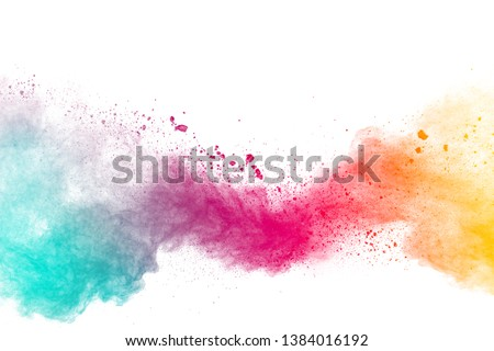 Abstract multicolored powder explosion on white background.Colorful dust explode. Painted Holi powder festival. #1384016192