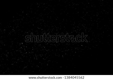 Abstract real dust floating over black background #1384045562