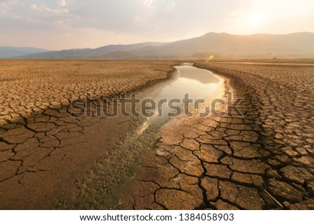 Dried lake and river on summer, Water crisis and Drouht impact case or climate change. #1384058903